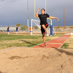 Lonnie Kamacho, junior, practices his form for the long jump.
