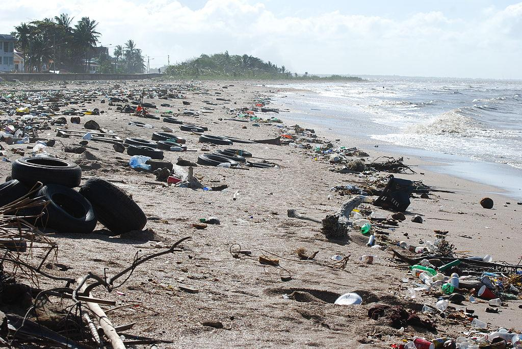 Garbage and debris pollutes the water as it accumulates off of the coast of Guyana