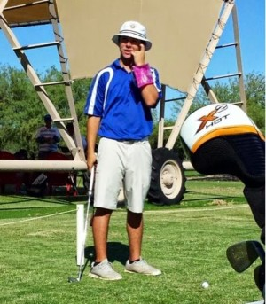 Aaron Prado, senior, wears his floatie on the golf course as he prepares for a possible assassination from another opposing team
