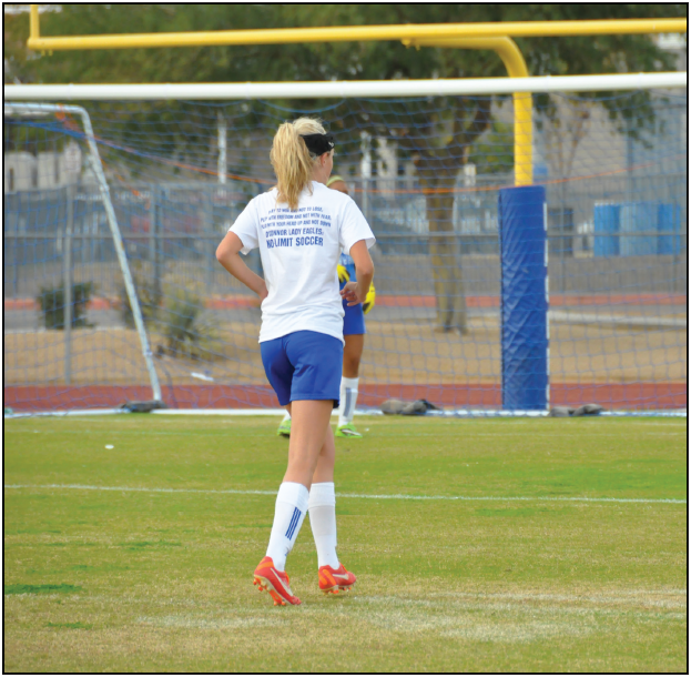 Savannah+Tidd%2C+senior+varsity+player%2C+prepares+for+a+game+by+practicing+hard+on+the+OHS+soccer+field+after+school+last+year.