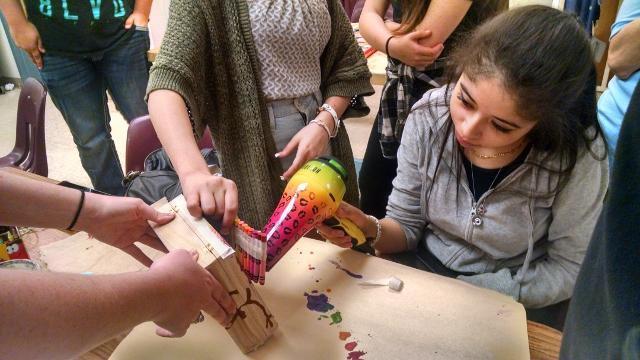 Aniah+Johnson%2C+senior%2C+with+Dena+Davis%2C+art+teacher%2C+and+Diandra+Baseu%2C+freshman%2C+are+melting+crayons+for+their+3D+art+project.