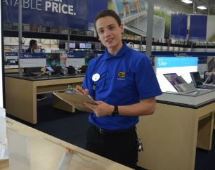 Nathan Winkle, junior, selling computers at his job at best buy.
