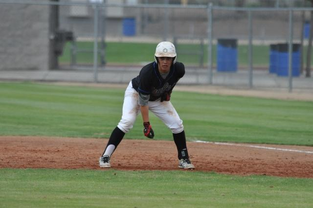 Dakota+Solis%2C+senior%2C+stares+at+homeplate%2C+ready+to+run+quickly%2C+as+soon+as+his+teammate+hits+the+ball.