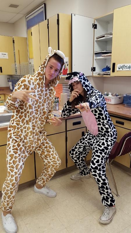 Dressed+to+impress%2C+Chris+Coppla%2C+junior%2C+and+Megan+Hunt%2C+sophomore%2C+sport+animal+onesies+for+Welcome+to+the+Outback.