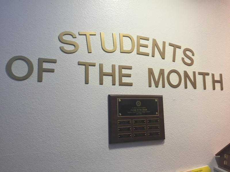 The+Student+of+the+Month+plaque+is+displayed+in+the+administration+building.