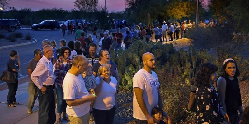 People+waited+in+line+in+Chandler%2C+Ariz.+to+vote+in+the+state%E2%80%99s+presidential+primary+on+March+22.+