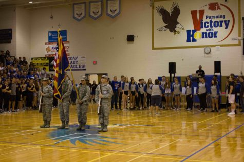 ROTC conducts the presenting of the colors, ready for the National Anthem to be sang by Honor Choir.