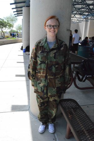 Jazmyn Hazen, senior, shows off her family member's uniform to inform people who her hero is.