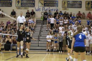 Sami Hover, senior, and Kelly Agnew, junior, bumps and sets the ball towards their opponent.
