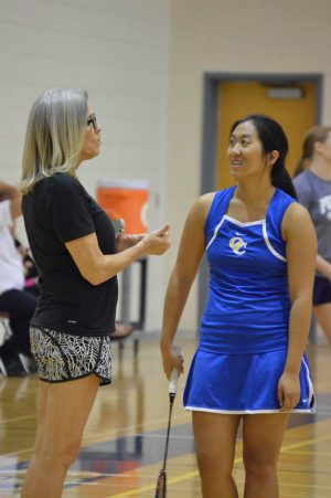 Coach Capp advises Tricia Tran, junior, to use new moves to lead the match for OHS against Perry.