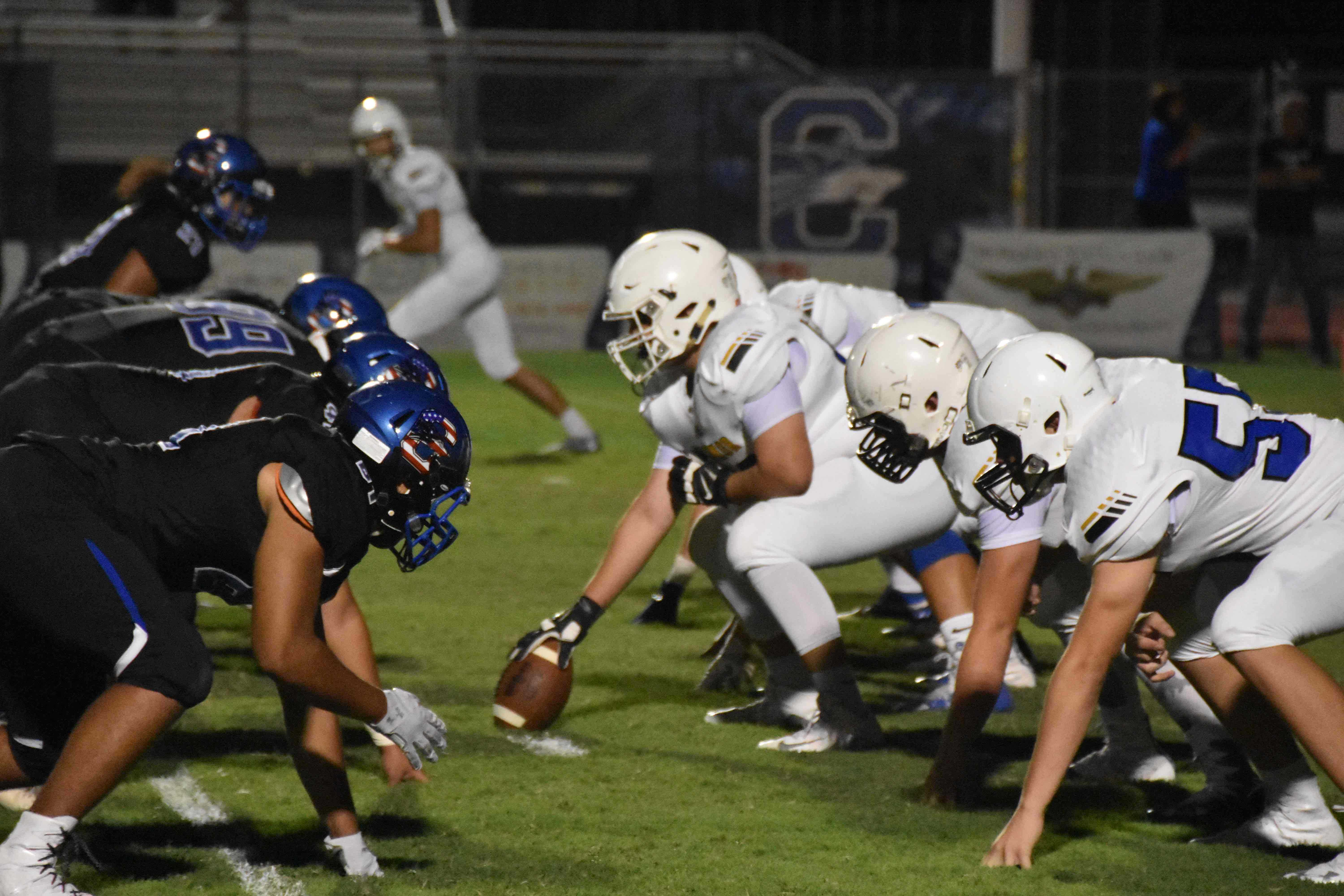 Ben Fuenmayor, sophomore, prepares to snap the ball in the game against Chandler.