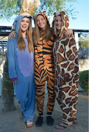 Freshmen Cortney Hansen, Ariana Rogers, and Aimee Kabello coordinate in their matching animal onesies for Thursday's spirit day.
