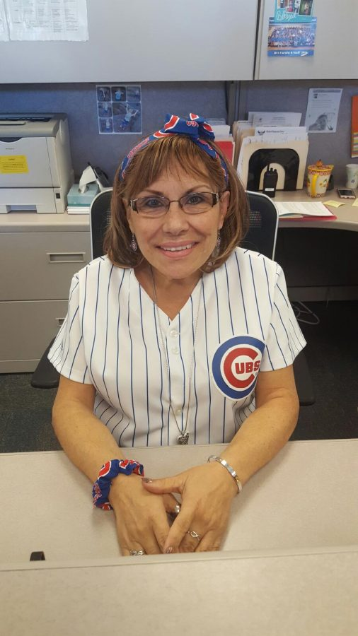 Rosa+Leptich%2C+conduct+secretary%2C+dresses+up+in+her+Cubs+gear+before+game+six%2C+to+root+for+her+favorite+team.+