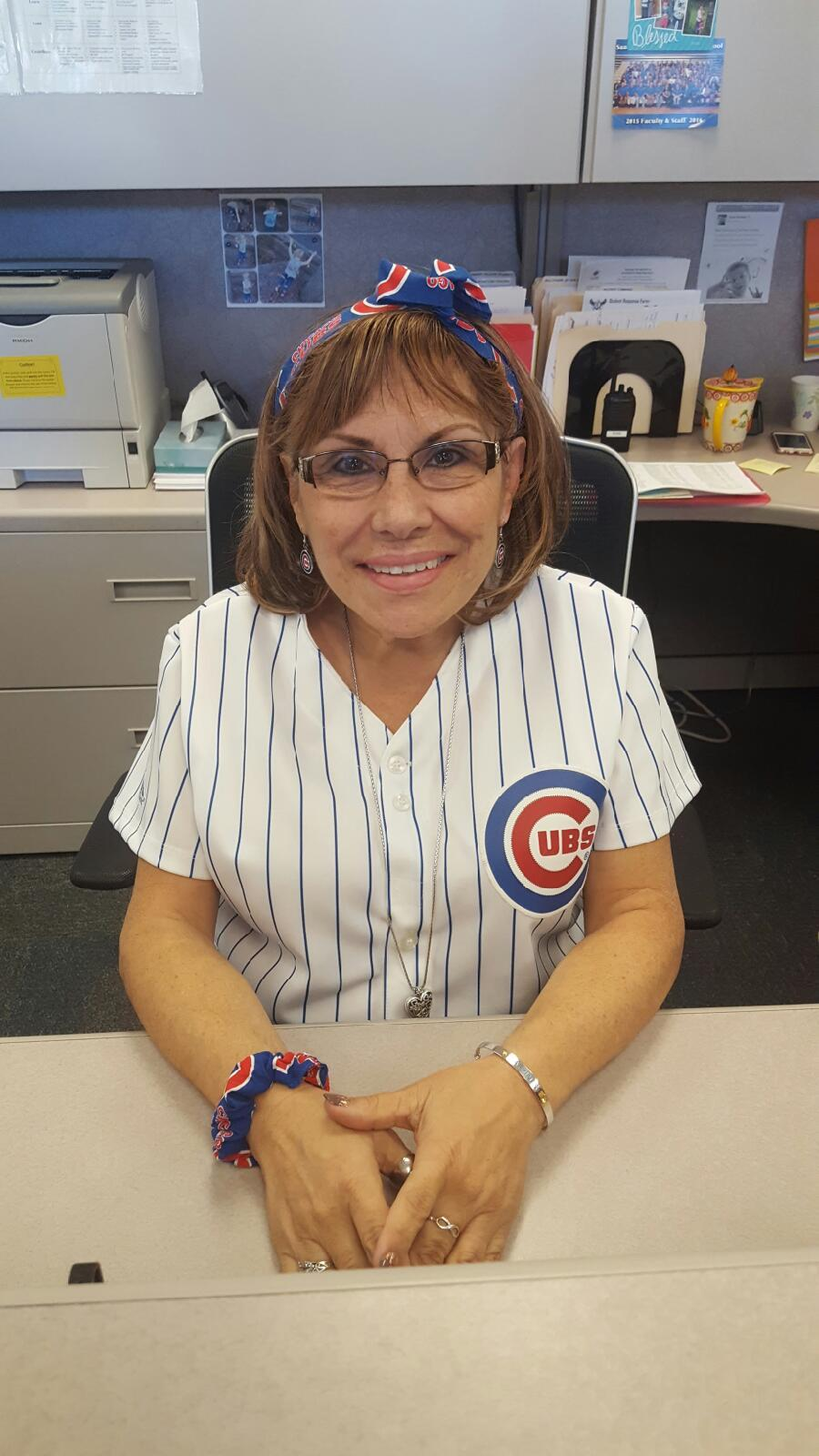 Rosa Leptich, conduct secretary, dresses up in her Cubs gear before game six, to root for her favorite team.