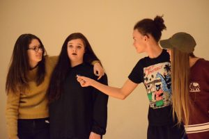 (Left to right) Eva Yont, Junior, Lauren Coe, junior, One Griffin, junior, and Mandy Moisoff, junior, play two-headed man, where each pair has a conversation with the other pair while trying to form coherent sentences with their partners.