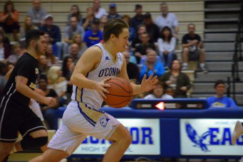Girls' basketball slam dunks into playoffs