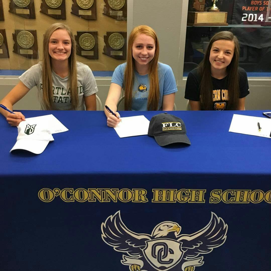(From left to right) Paige Donathan, Ally Eller and Maddie Soles sign a contract to go to a specific college.
