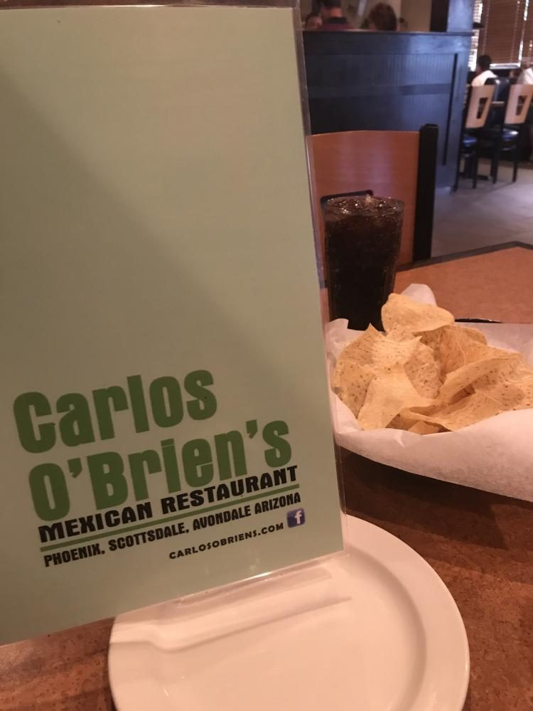 A+menu%2C+chips%2C+and+Dr.+Pepper+sit+on+a+table+at+Carlos+O%27Brien%27s+as+customers+decide+what+to+order.+