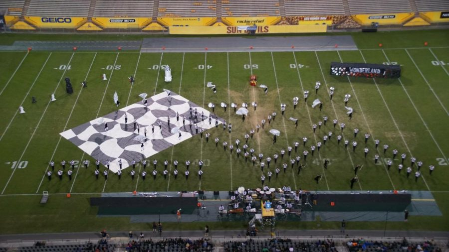 A+birds-eye+view+of+the+Eagle+Pride+Marching+Band+performing+their+show+%22We%27re+All+Mad+Here%22+at+Superstate.