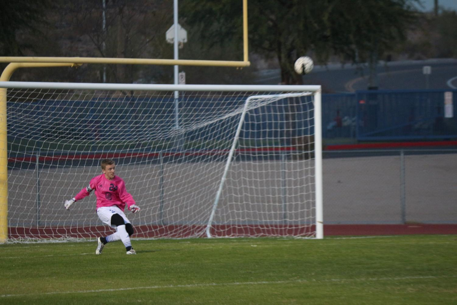 Chase Toncheff, junior, kicks the ball back into the action.