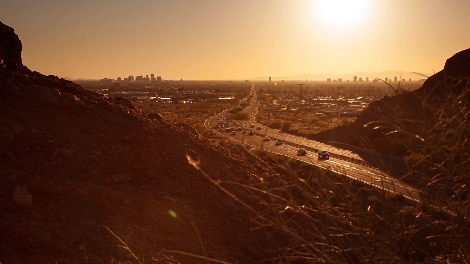 Photo courtesy of Video Blocks user Clippn. A screencap from the timelapse of an Arizona sunset taken above a highway.