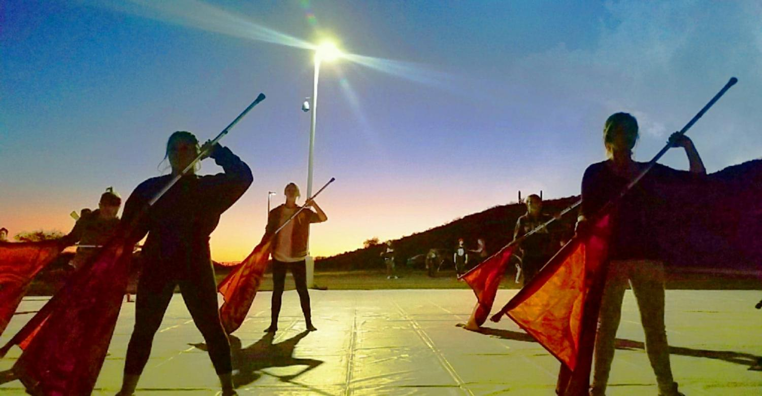 As the sun sets, winter guard keeps practicing for their new show,