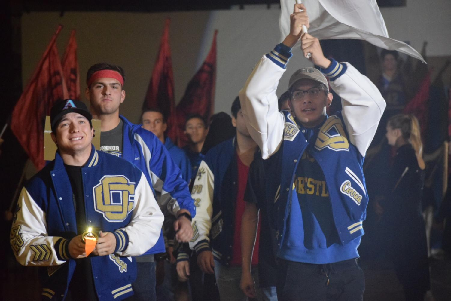 Wrestling waves their flag through the opening ceremony of the Olympic OC Assembly