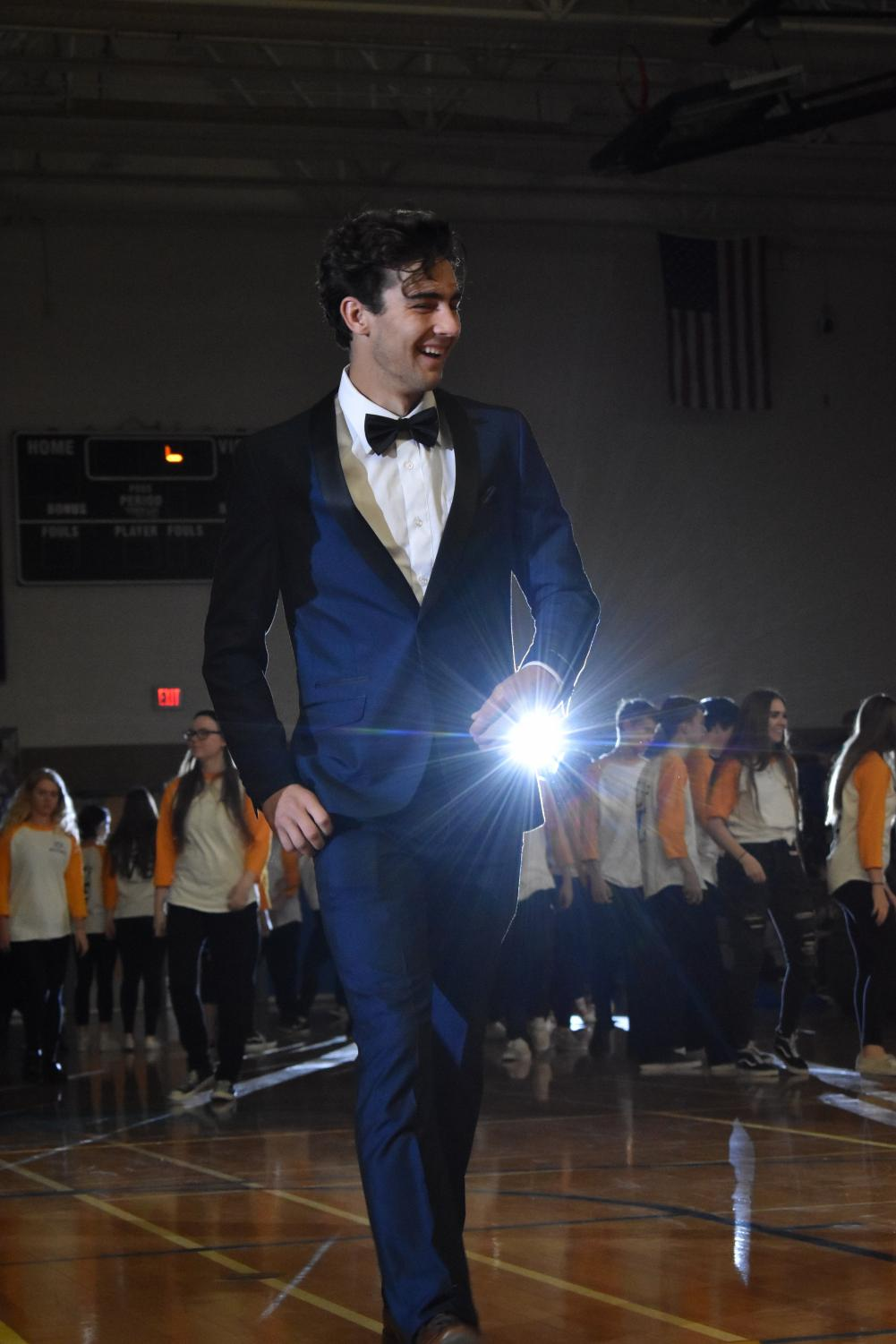 Will Harris, senior, walks across the floor at the Olympic OC Assembly