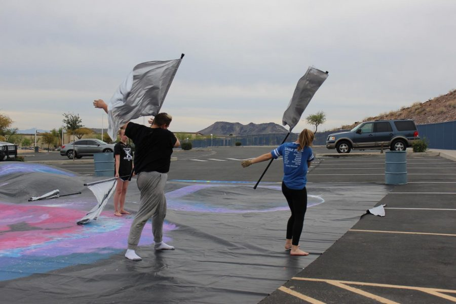 Petie+Zufelt%2C+senior+%28left%29%2C+and+Hannah+Kalas%2C+junior+%28right%29%2C+practice+a+move+with+their+flags+during+an+afternoon+rehearsal.+