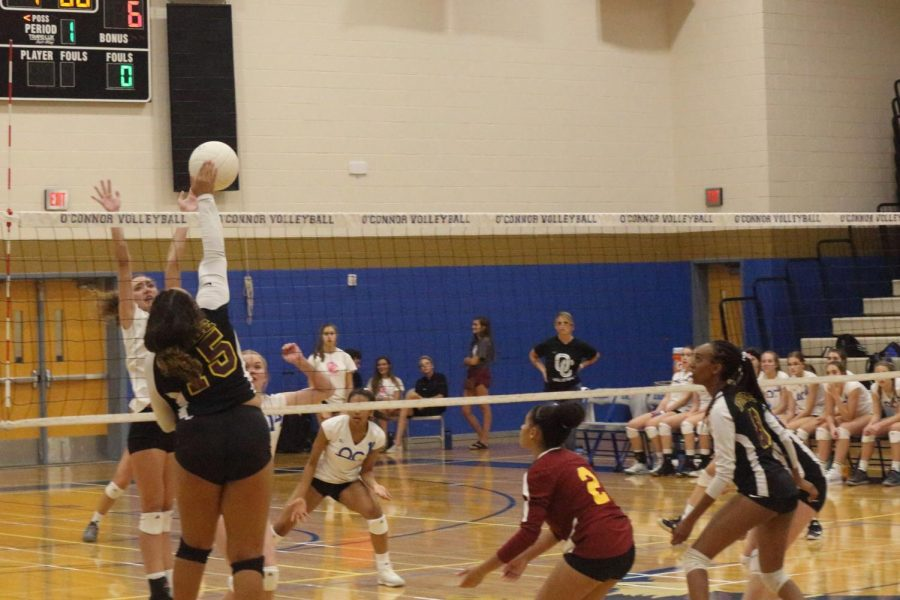 The+JV+team+goes+up+for+a+block+against+Chaparral+on+Oct.+2.+OHS+won+2-0