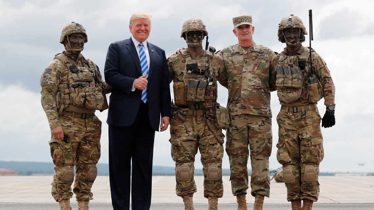 Donald Trump, pictured second to left, ordered 5200 new border troops to patrol the border in the wake of a caravan of Guatemalan migrants.