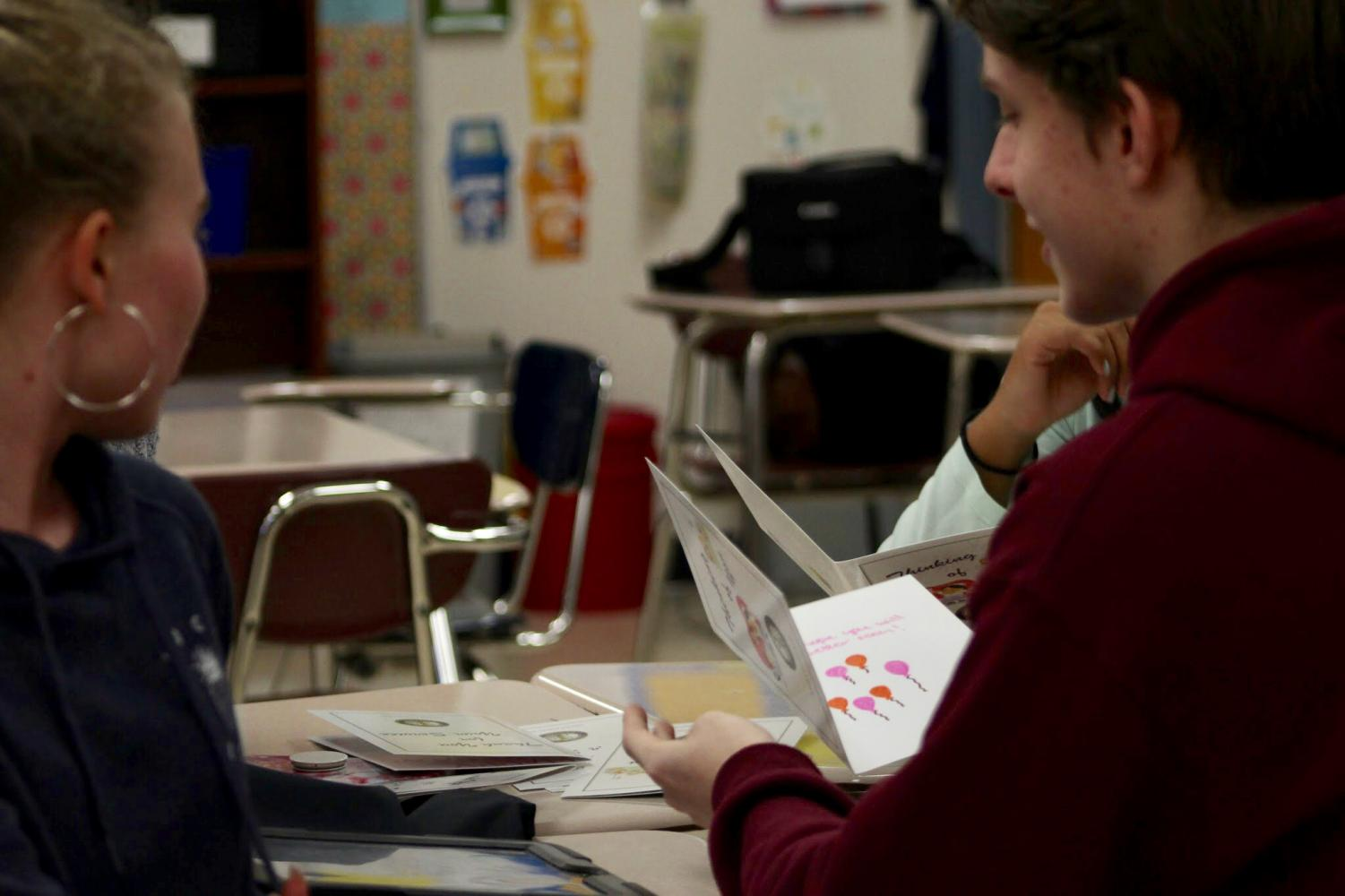 The Interact Club makes cards for veterans.