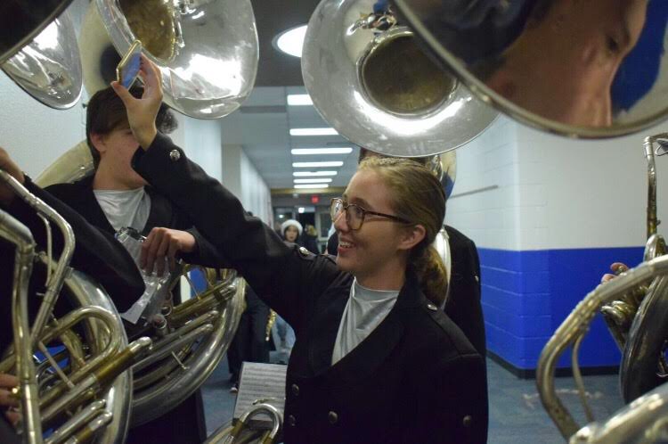 Braedyn Pentowski, sophomore, helps prepare others to perform a wonderful winter concert.