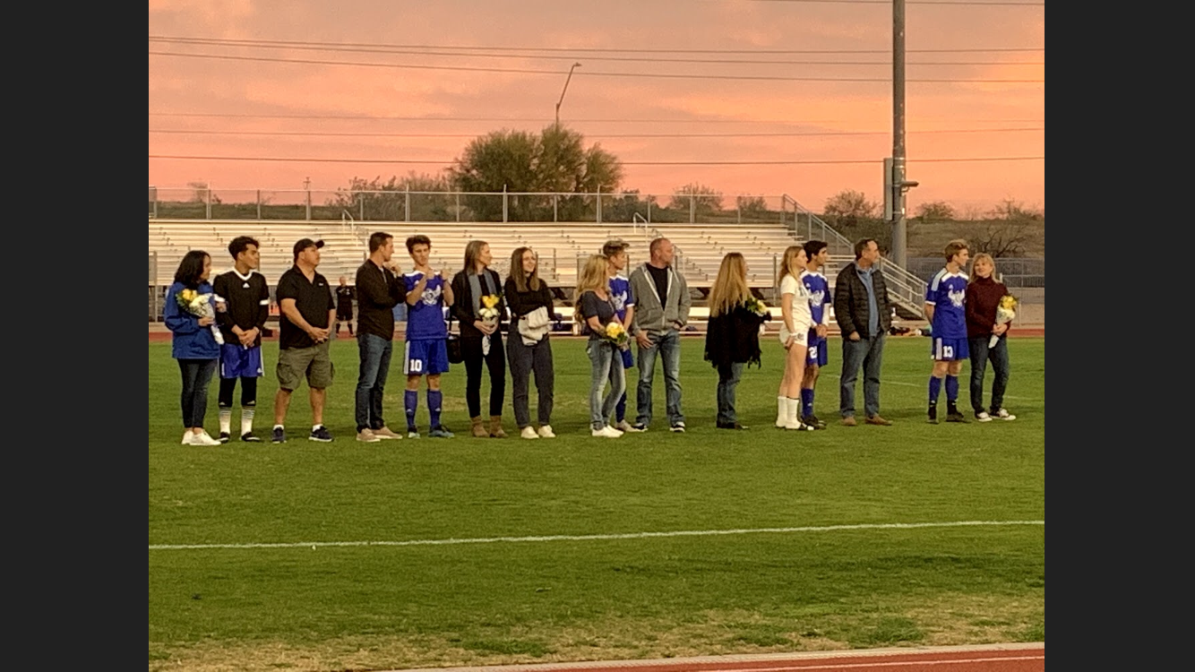 Seniors gather with their families on senior night to celebrate their successes and the hard work put into this year's season.