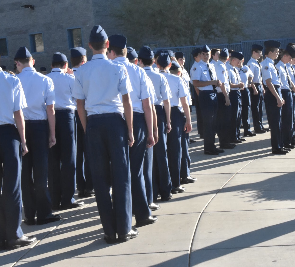 ROTC greets students as they enter school.