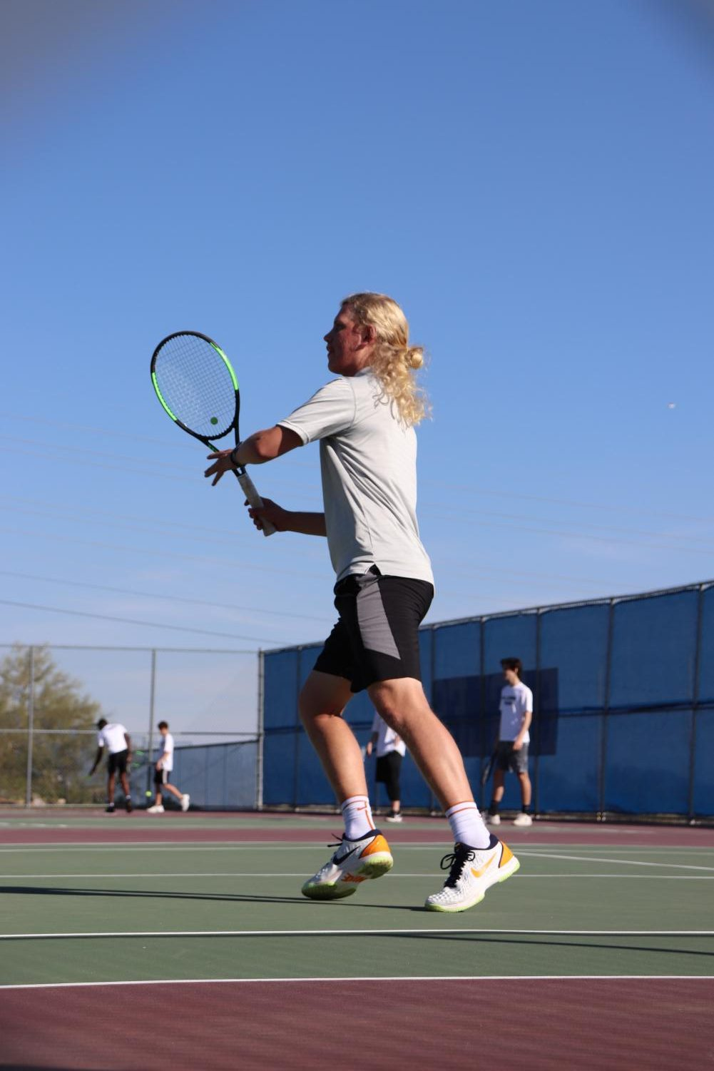 Soren Younger, senior, warms up for his match against Millennium.
