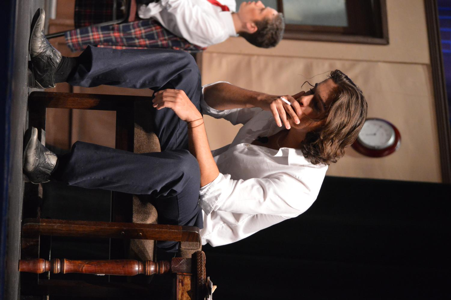 Delan Hafeed, junior, pretends to smoke during the play.