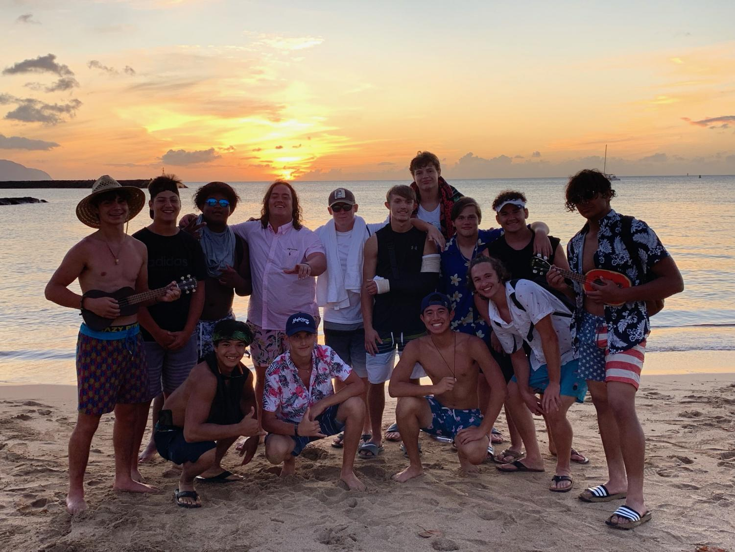Photo Courtesy of Andrea McCall OHS football players visit the beach during their trip to Hawaii.