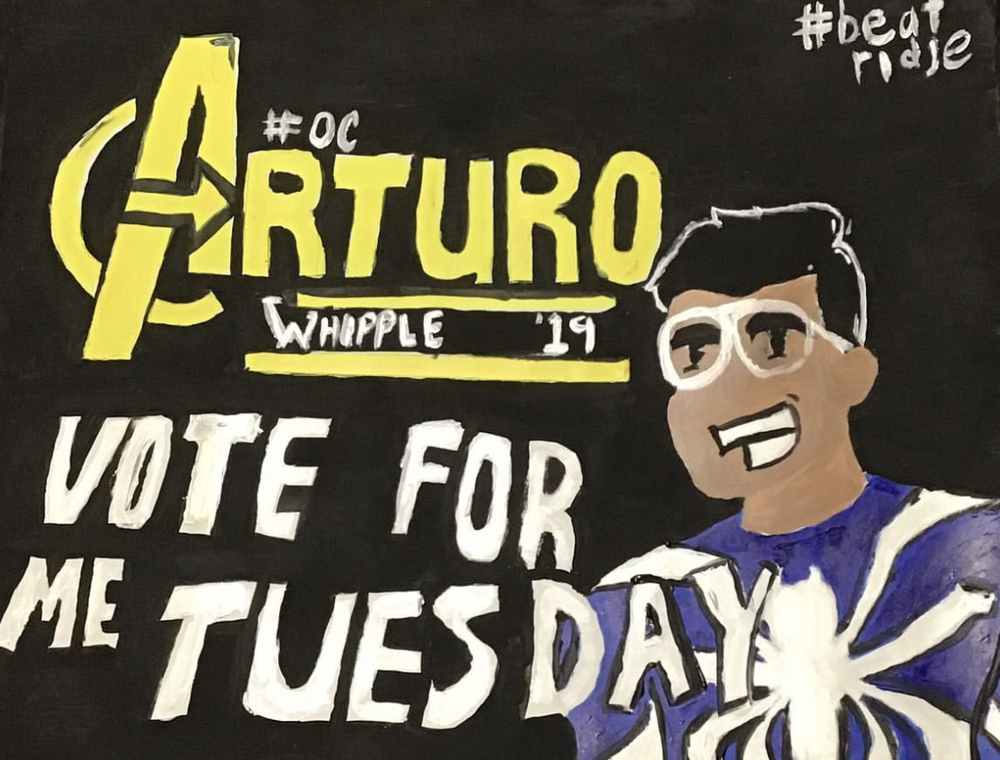 Students put posters up around campus to campaign for STUGO position.