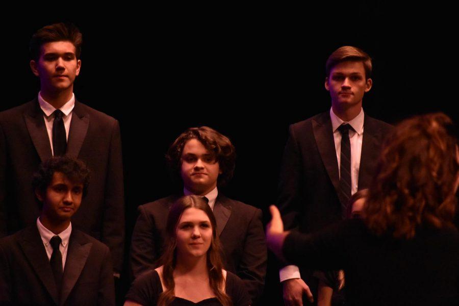Conductor%2C+Anna+Backstrom%2C+leads+the+choir+through+the+concert.