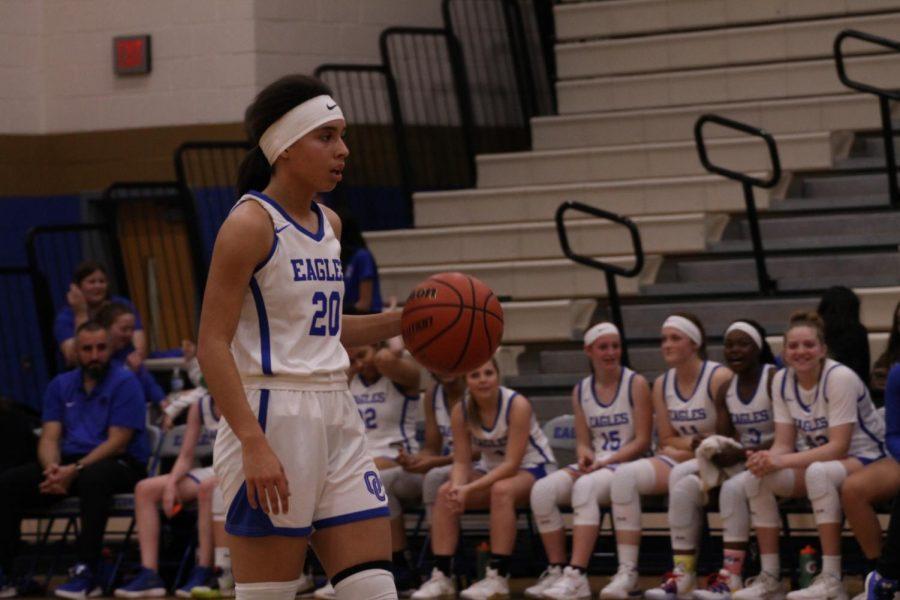 Lauren+McIver%2C+senior%2C+dribbles+the+ball+up+the+court.