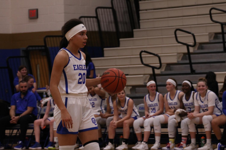 Lauren McIver, senior, dribbles the ball up the court.
