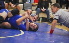 Wrestling pins the competition to the ground