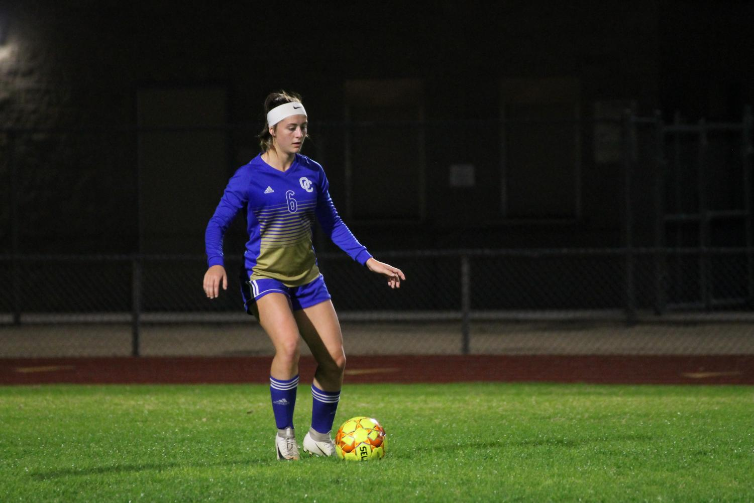 Harlee Kuntz, junior, dribbles the ball during OHS' game against Highland on Dec 6. OHS lost the game 2-1.
