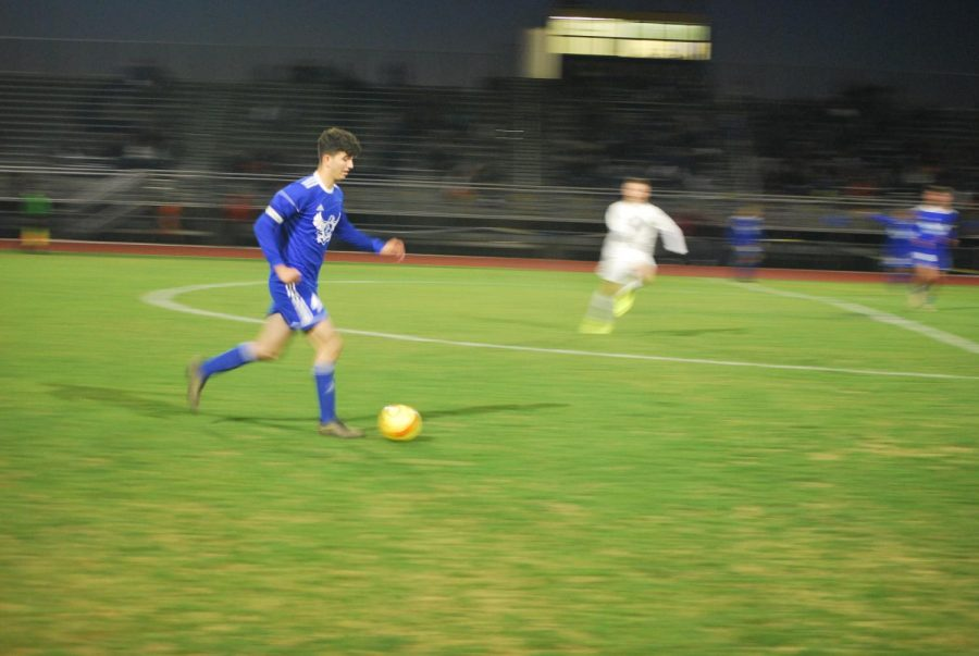 Nick Ticknor, senior, moves the ball upfield.