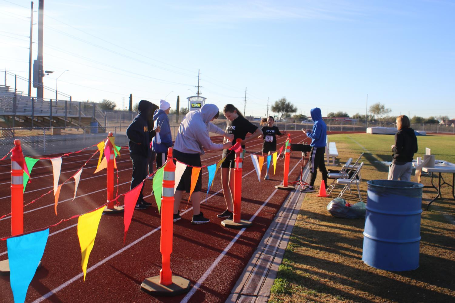 The first and second place girls 5k racers cross the finish line after a successful race.