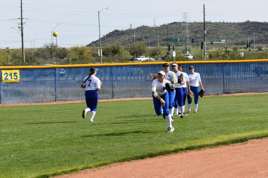 The team practices their throws on the field.