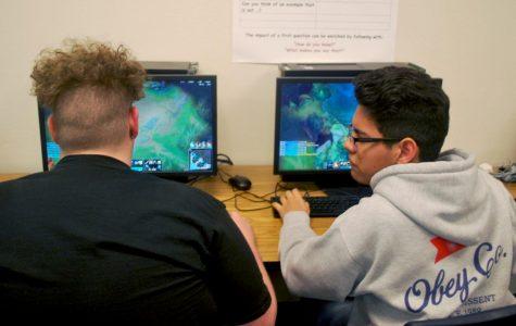 Eric Barron, junior, and Elias Lopez, junior, improve their gaming skills.