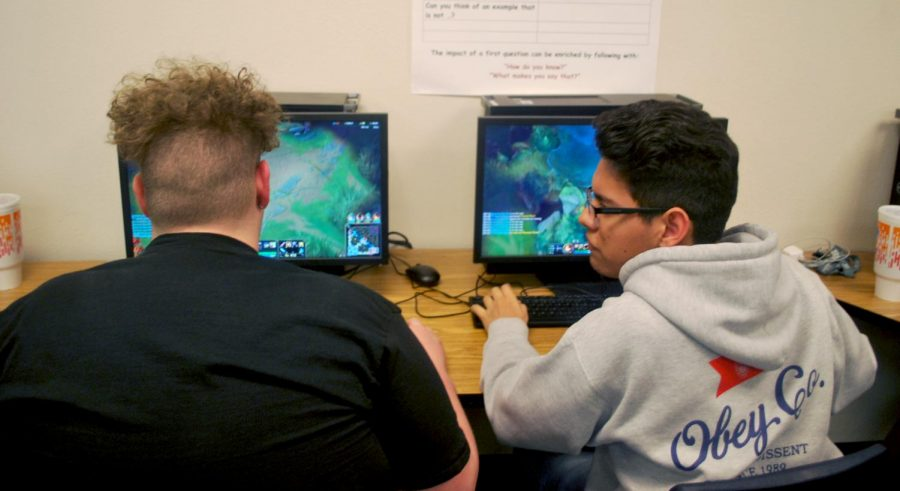 Eric Barron, junior, and Elias Lopez, junior, improve their gaming skills.