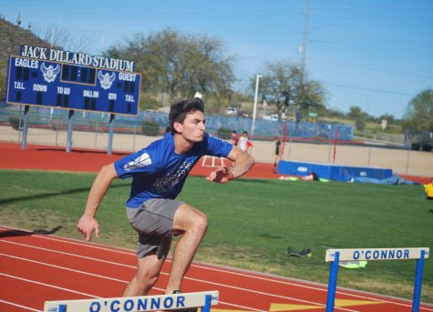 Brian Hubbard, senior, practices jumping hurdles with better precision.